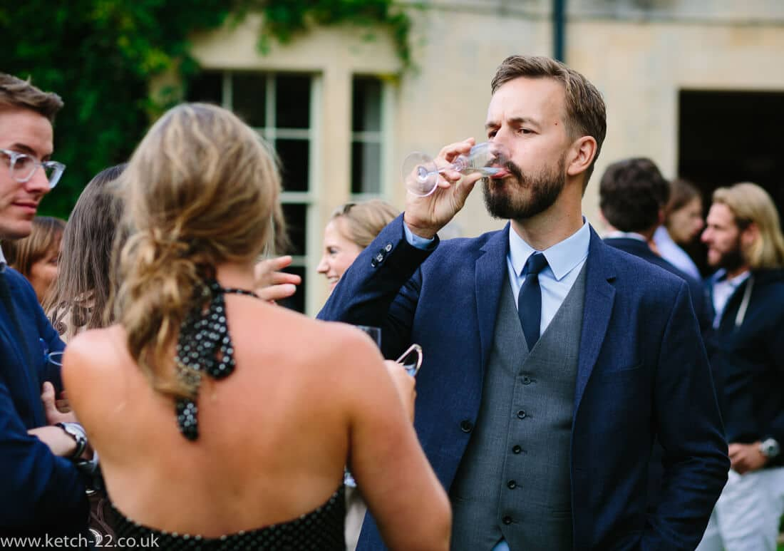 Wedding guest drinking champagne