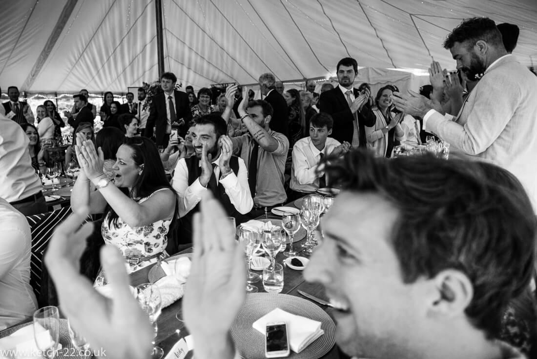 Wedding guests cheering bride and groom at Winchcombe wedding