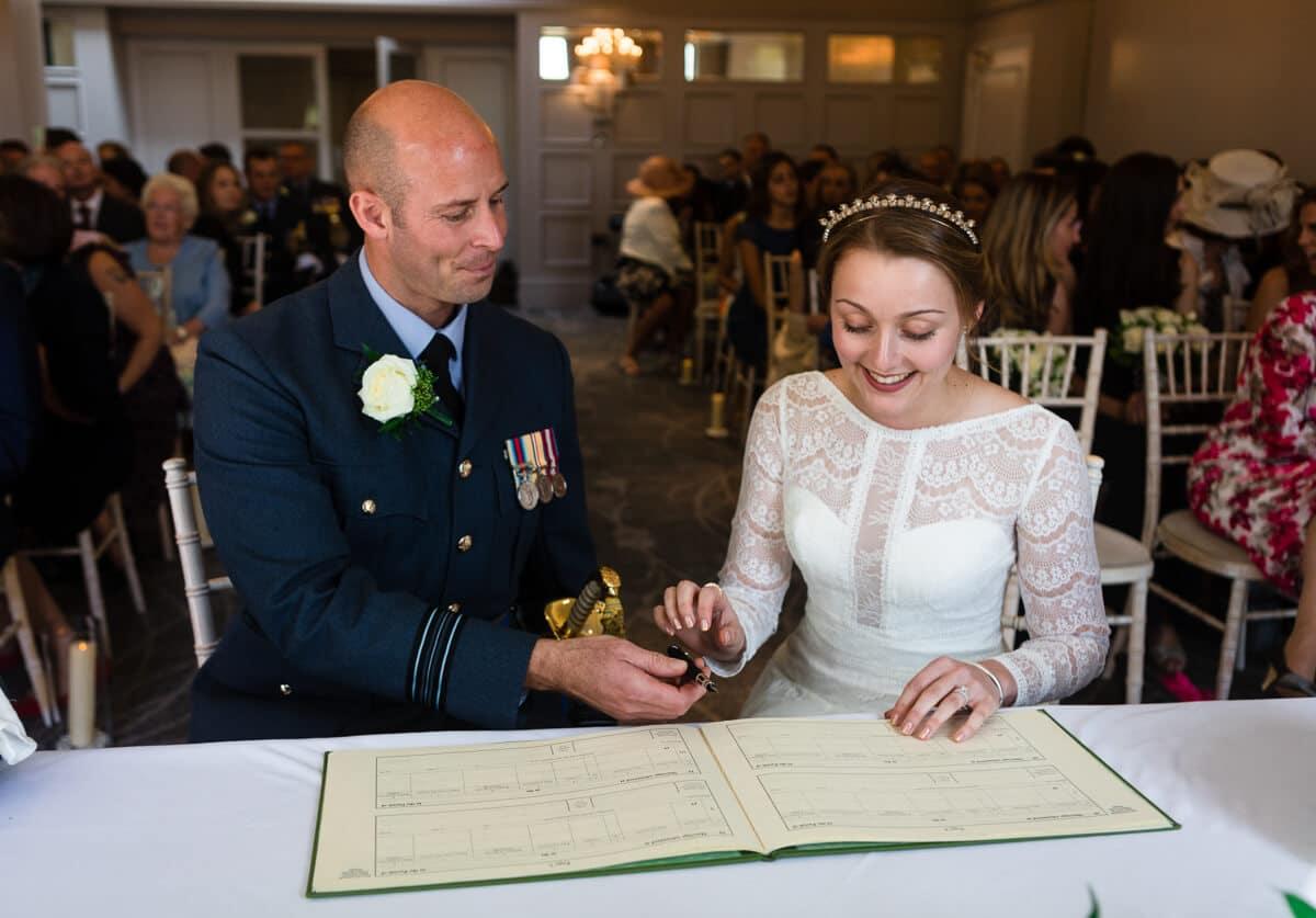 Bride and groom signing the wedding registrar
