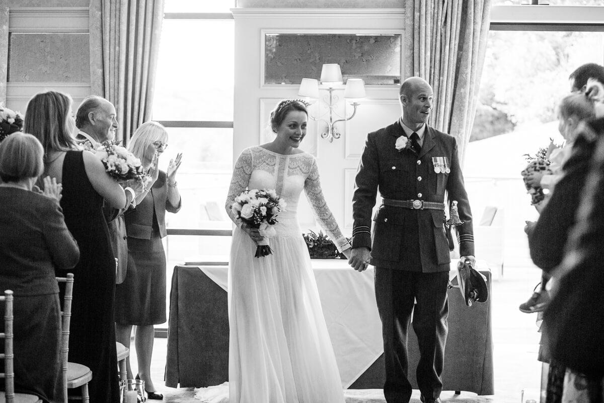 Bride and groom leaving the De Vere Estate Wedding ceremony