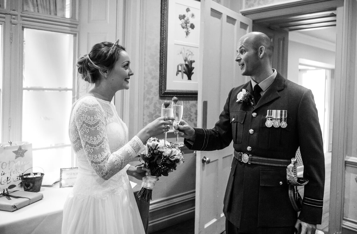 Bride and groom toasting eachother just after wedding