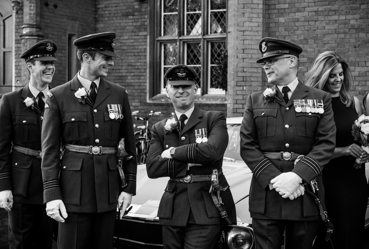 RAF groomsmen sharing a funny moment