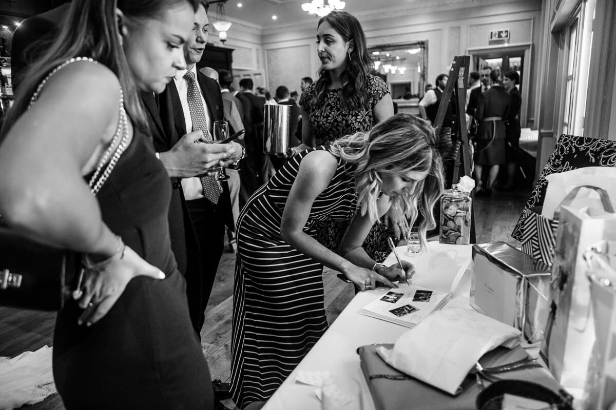 Guests signing wedding book