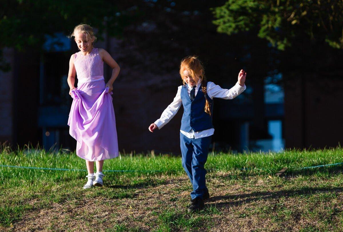 Kids playing at summer wedding