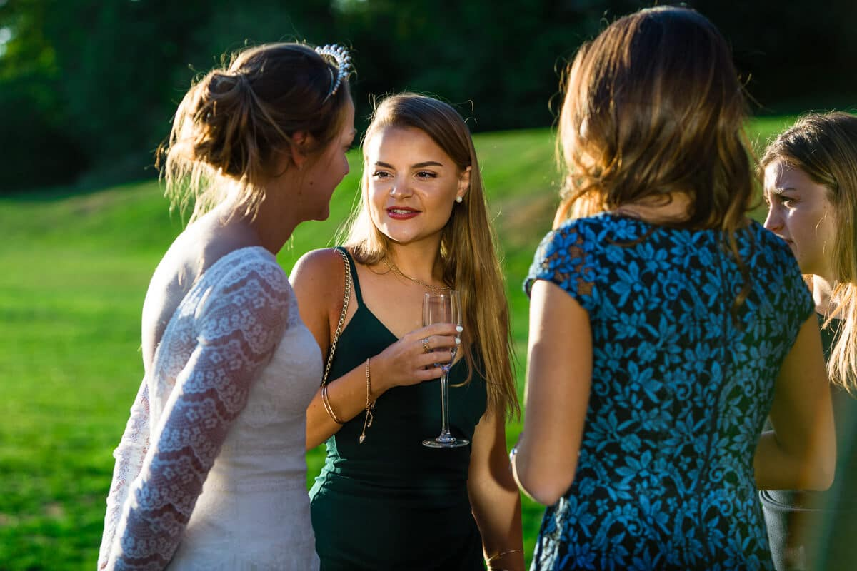Bride chatting to her friends at reception