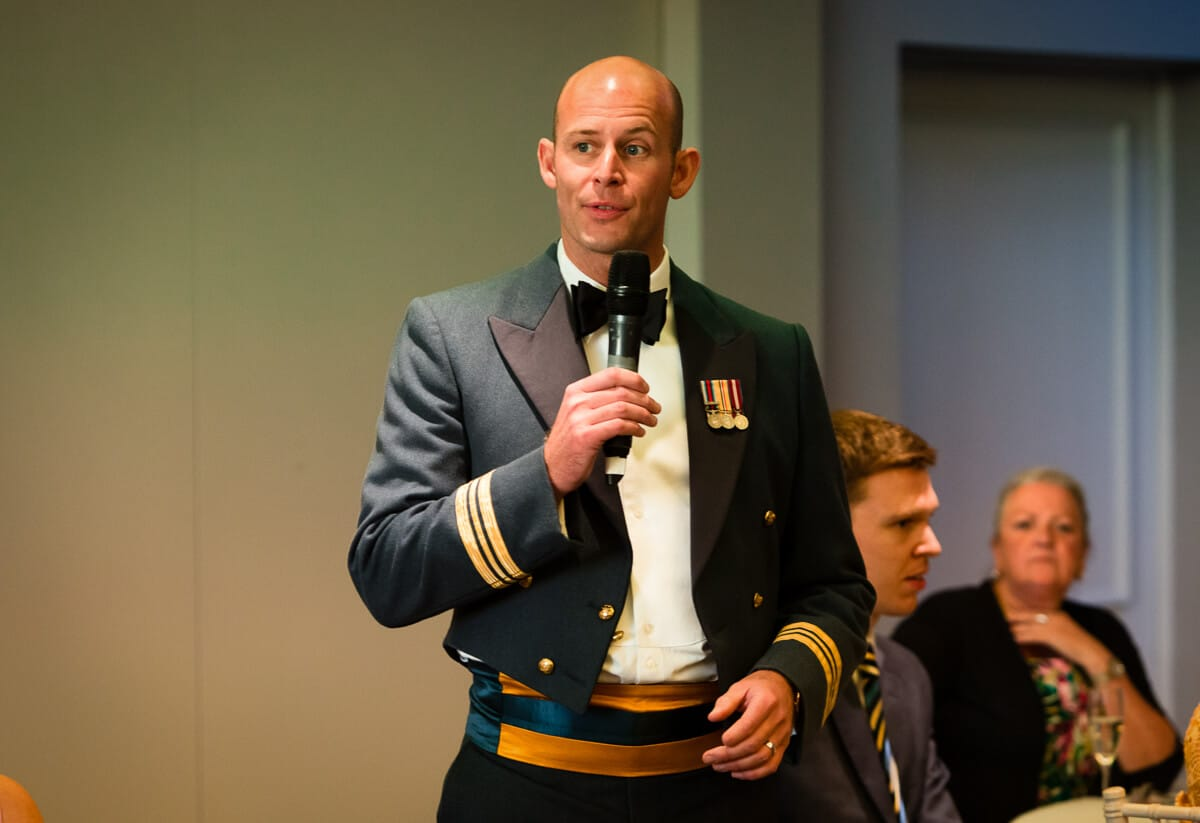 Groom in RAF uniform making speech