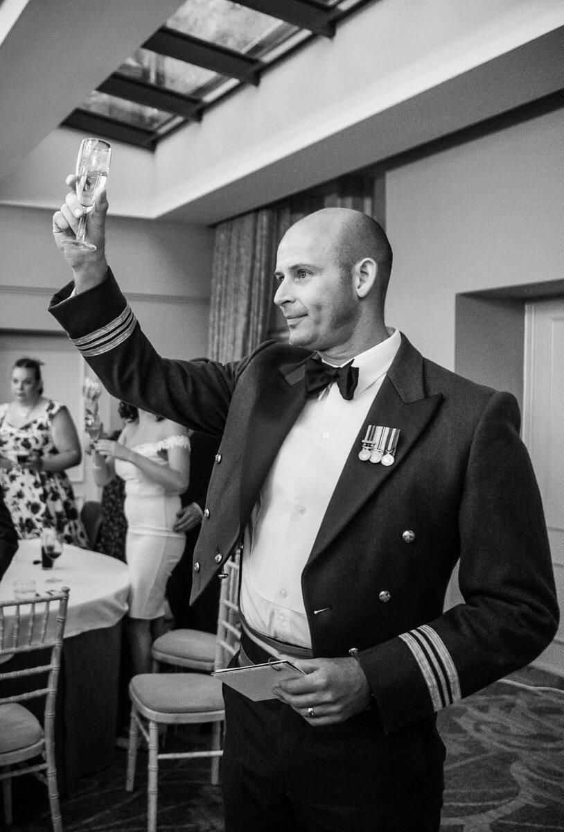 Groom raises a glass to the bride