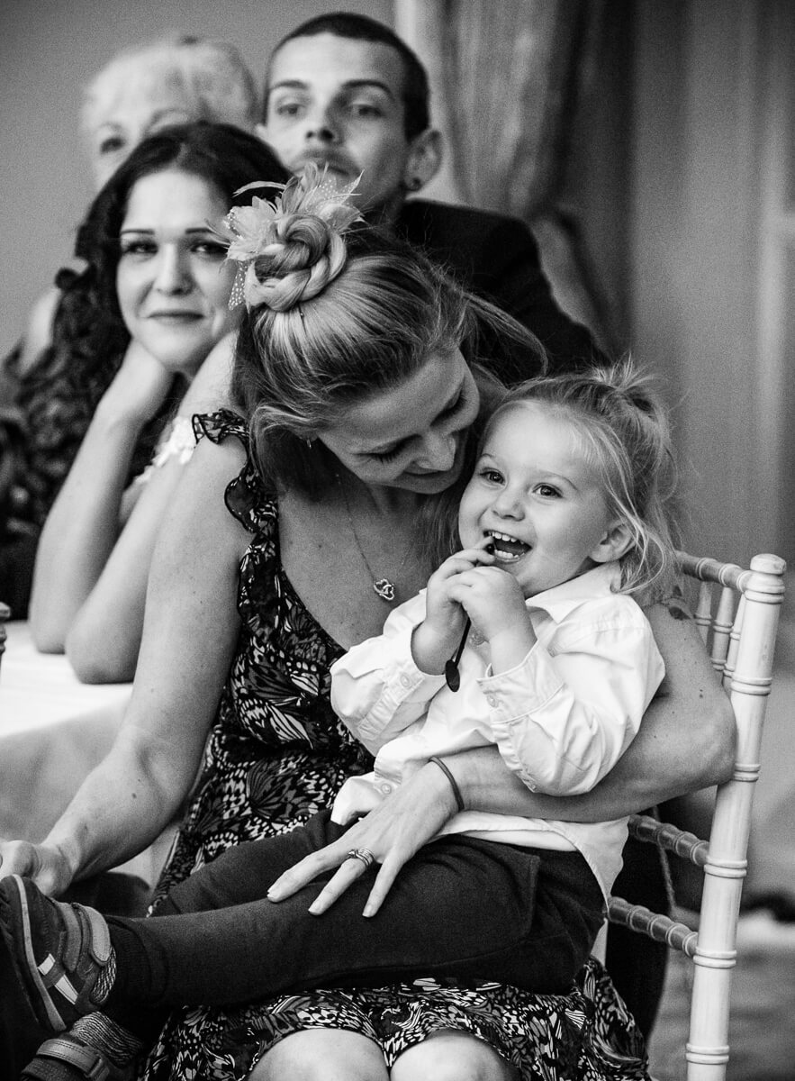 Mum and laughing little girl at speeches