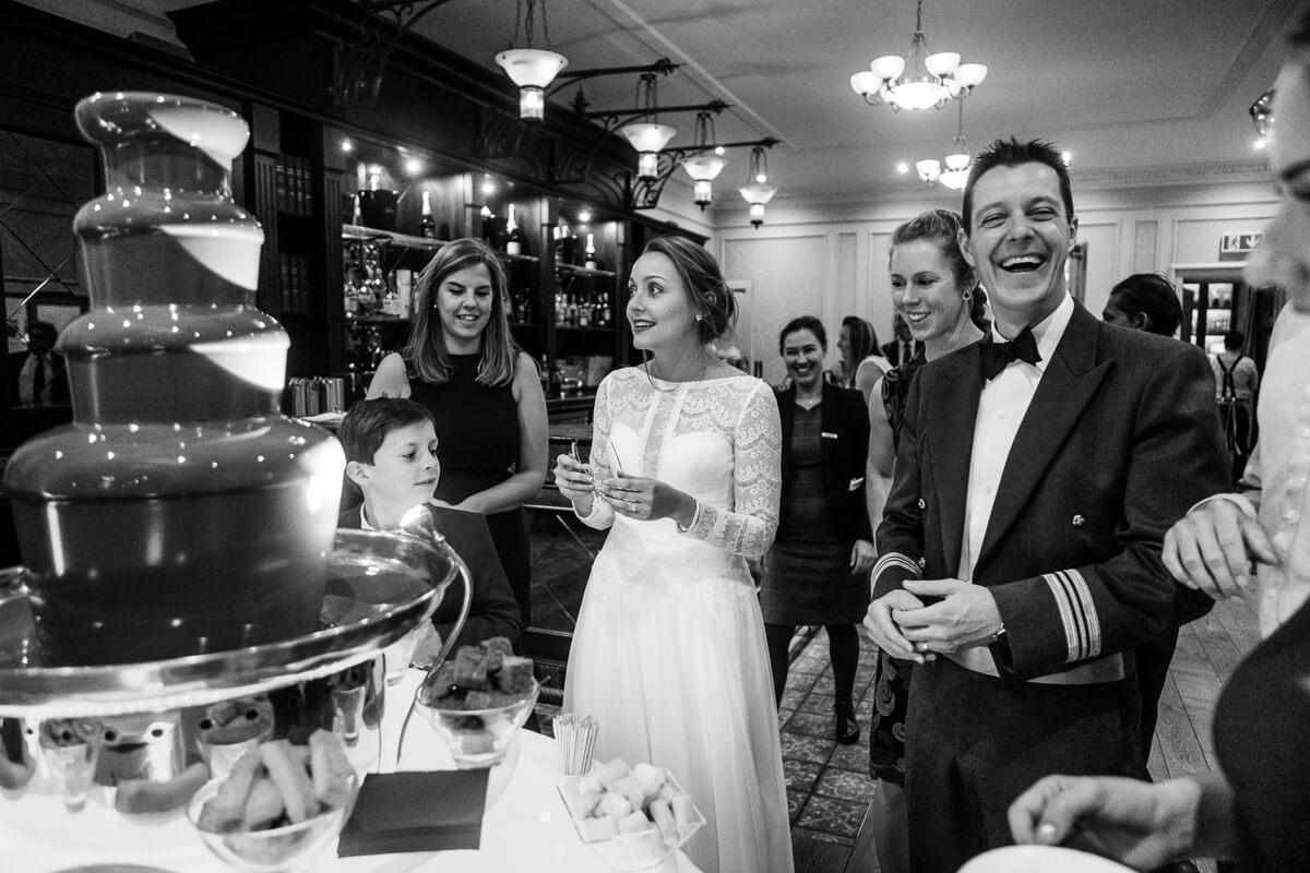 Bride and groom enjoying chocolate fountain at de Vere Latimer wedding