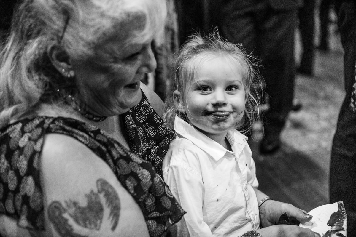 Little girl with chocalate on her face at De Vere Latimer Estate wedding