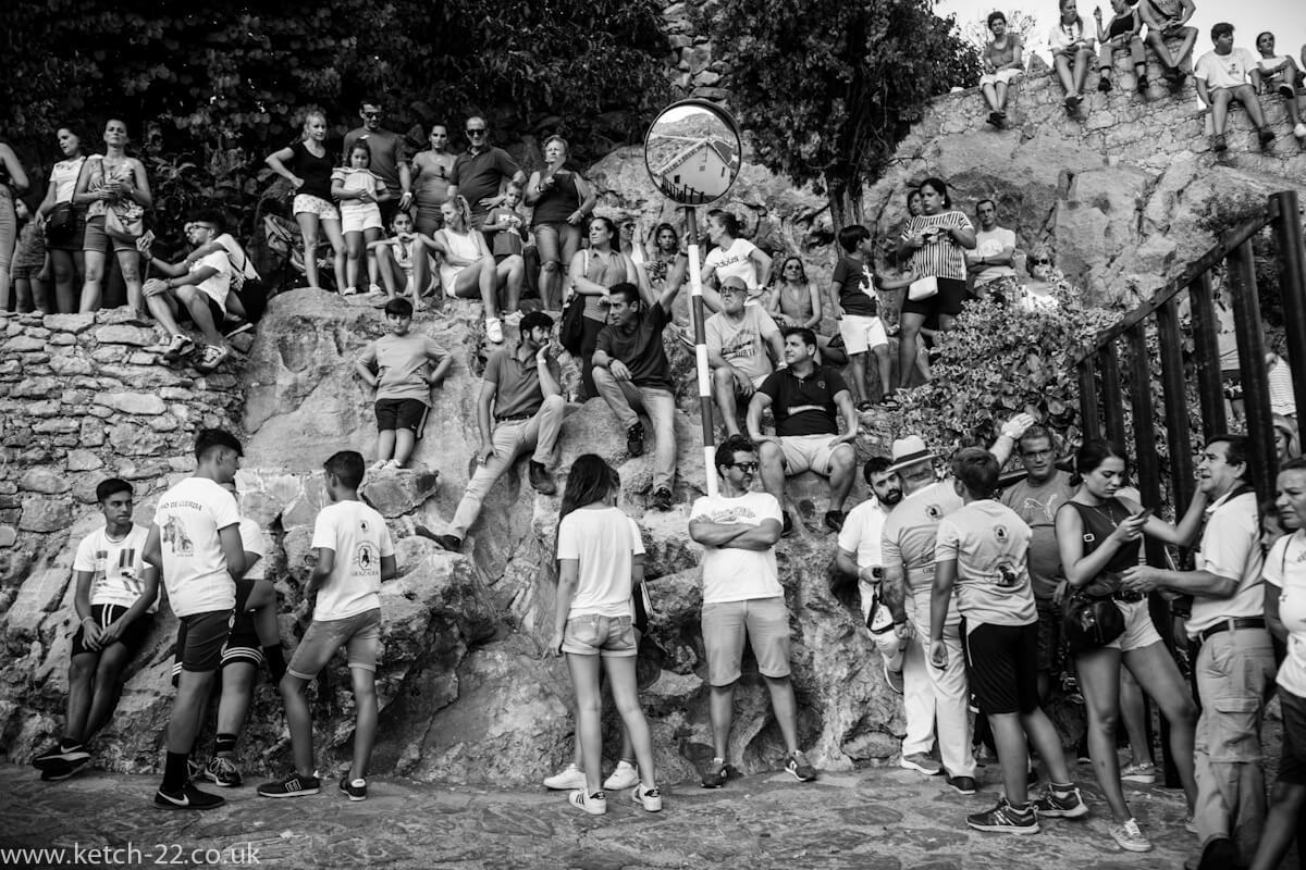 Images of Grazalema national park with spectators at fiesta in Villaluenga