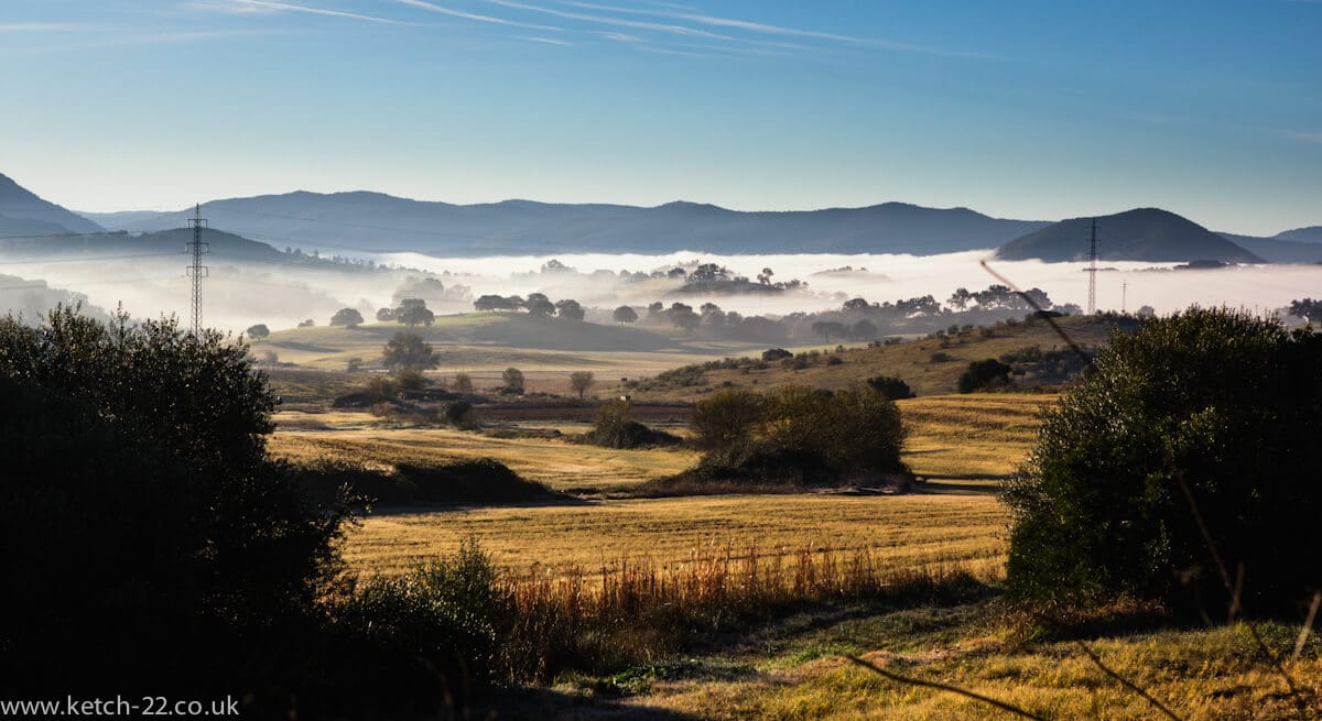 Sunrise with early morning mist over fields in Grazalema Natural Park