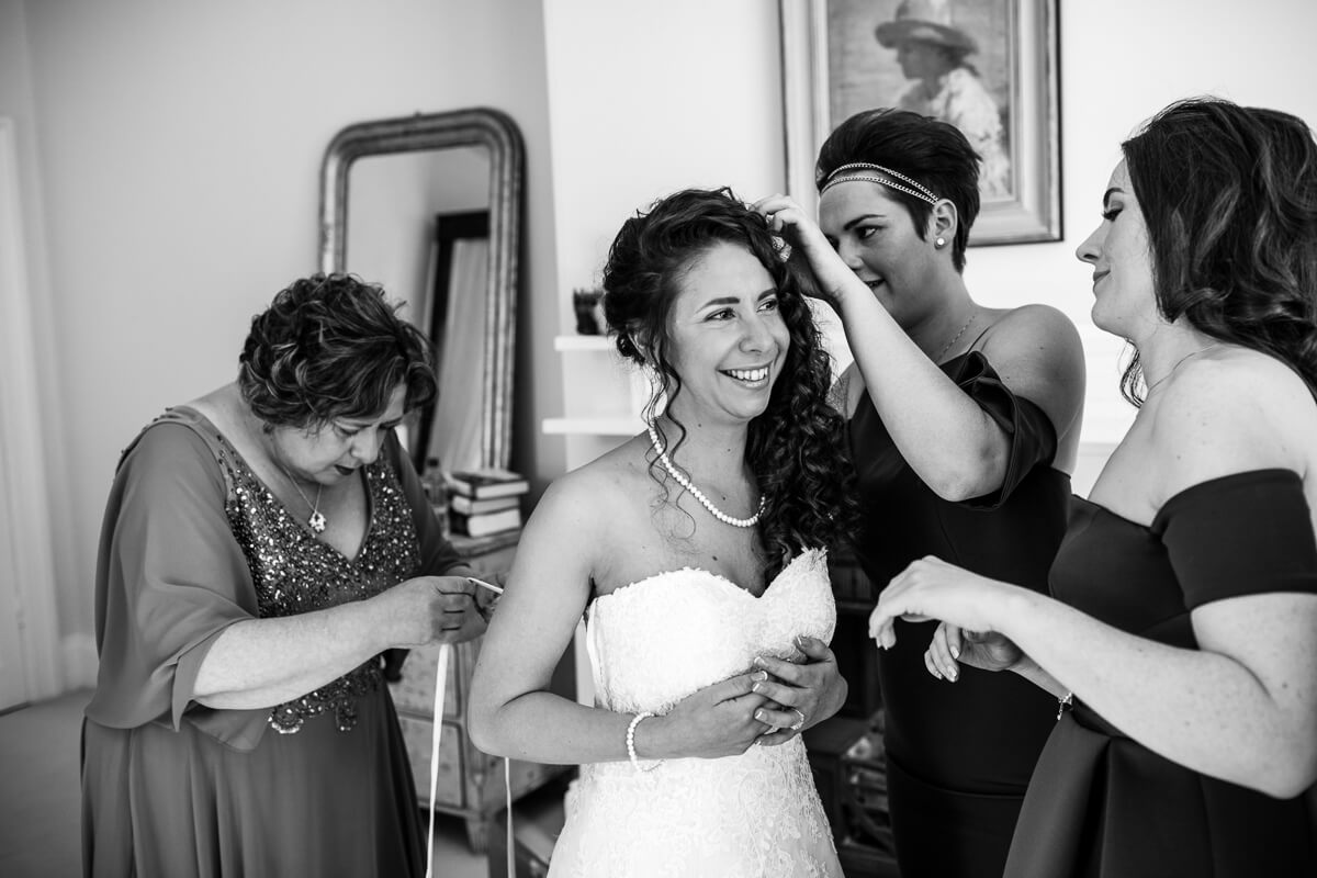 Natural photo of bride getting ready at Matara Centre wedding
