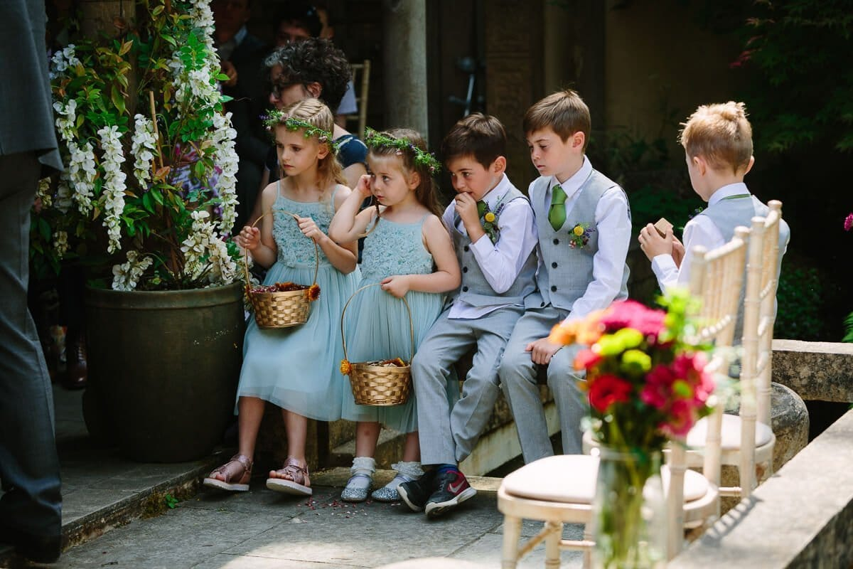 Page boys and flower girls at wedding ceremony