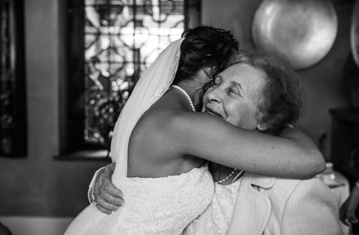 Bride hugging grand mother