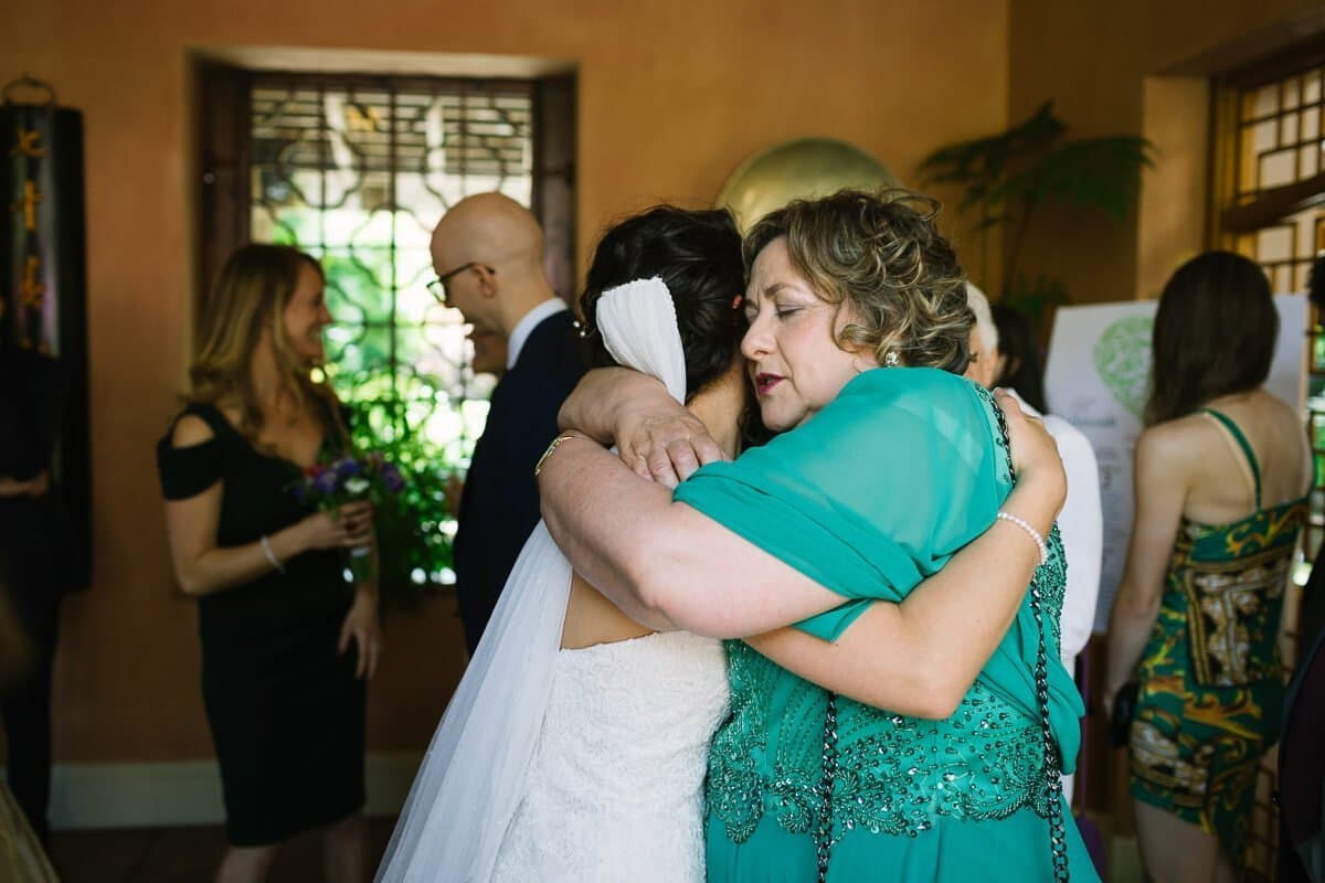 Mother of bride hugging her daughter