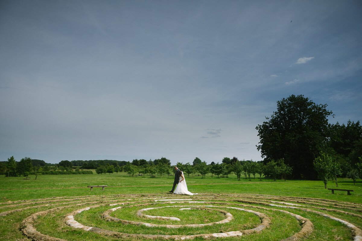 Bride and groom walking around spiral circle at Matara Centre Wedding