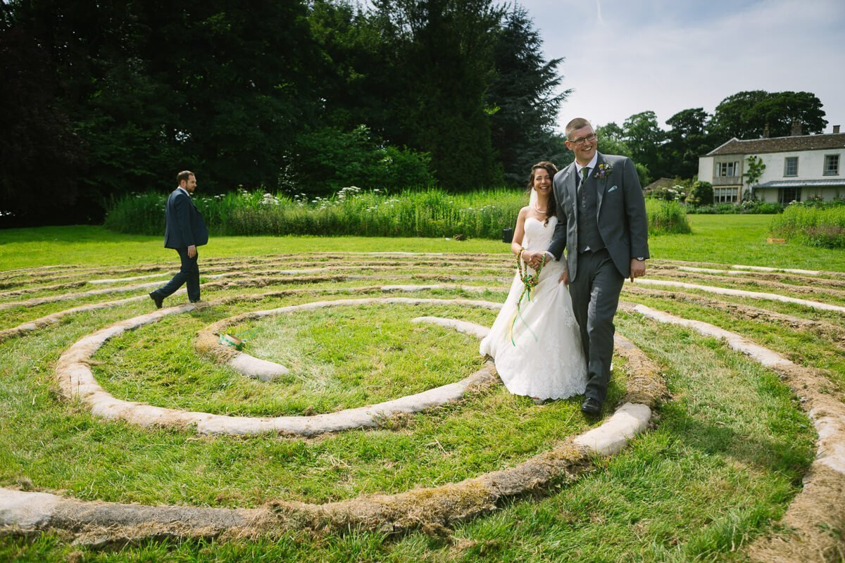 Newly weds walking around spiral circle at Matara Centre