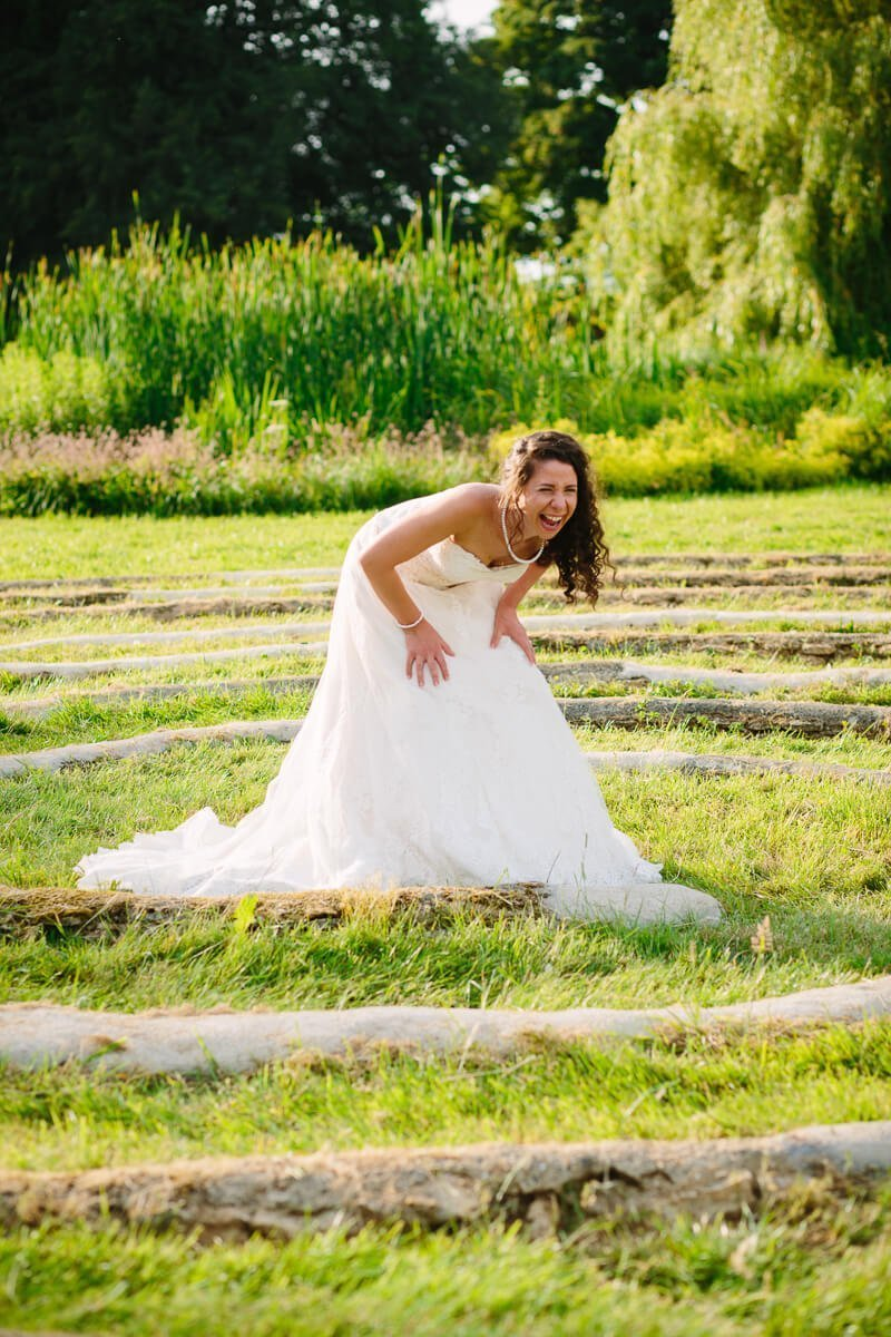 Bride laughing in gardens at Matara Centre