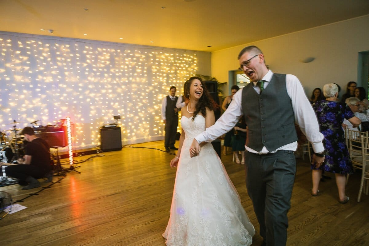 Bride and groom walk on to dance floor