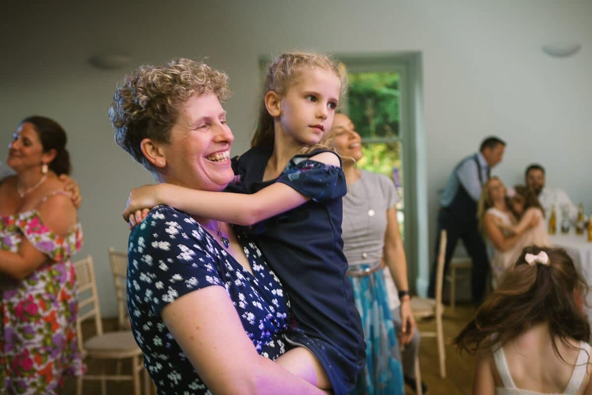 Mother and girl on dance floor at wedding