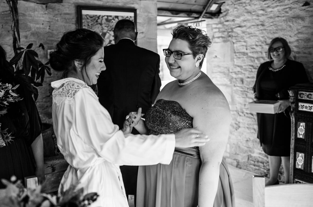 Wedding guest greeting bride