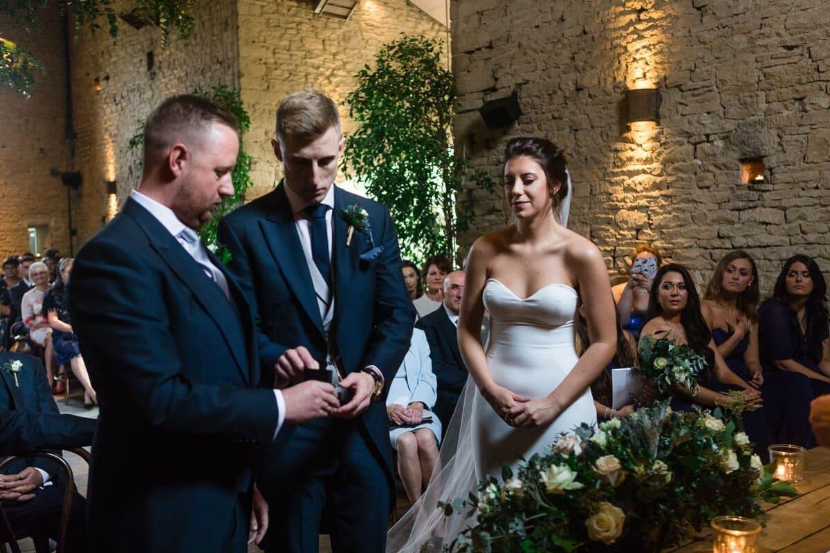 Bestman giving groom rings