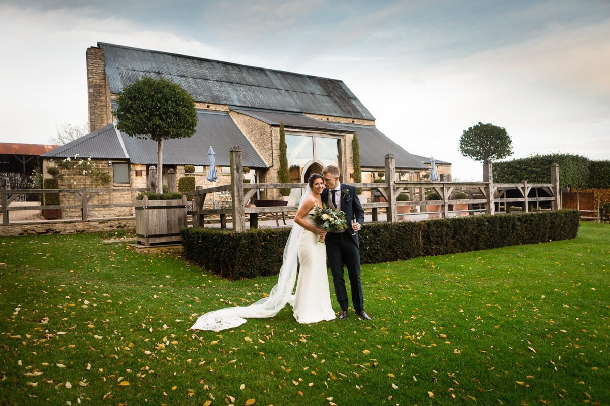 Bride and groom in front of Cripps Barn Wedding venue