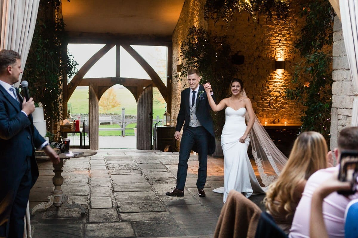 Bride and groom make grand entrance at Cotswold wedding Cripps Barn in Gloucestershire