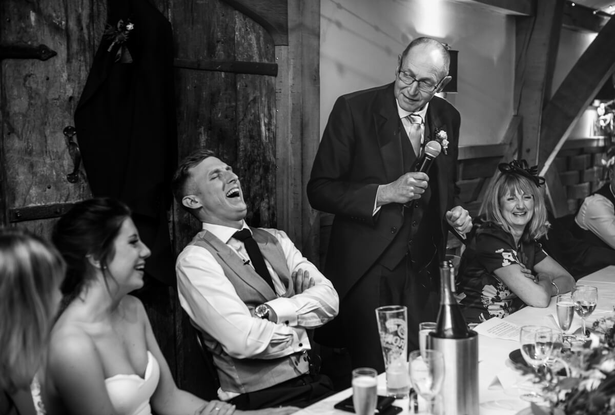 Father of bride amuses groom during wedding speeches