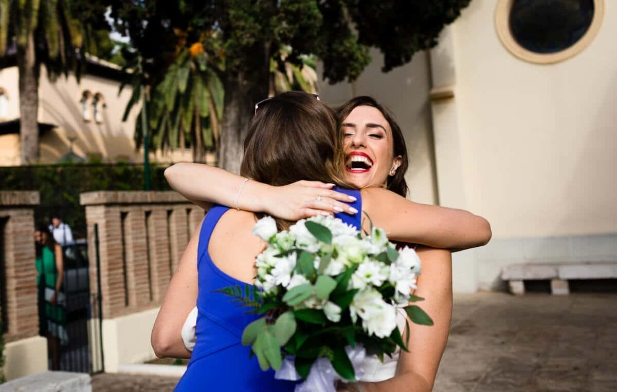 Wedding guest greeting bride