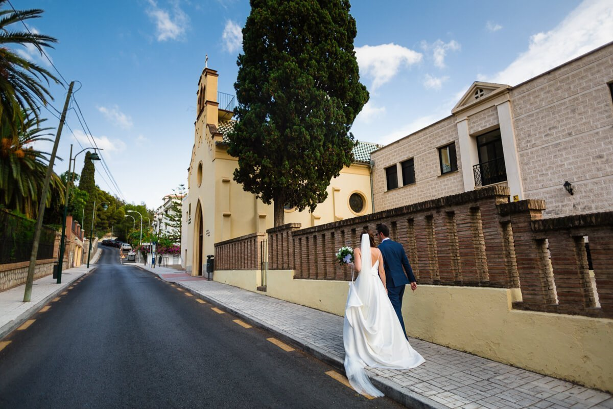 Bride and groom walking to church at Spanish wedding