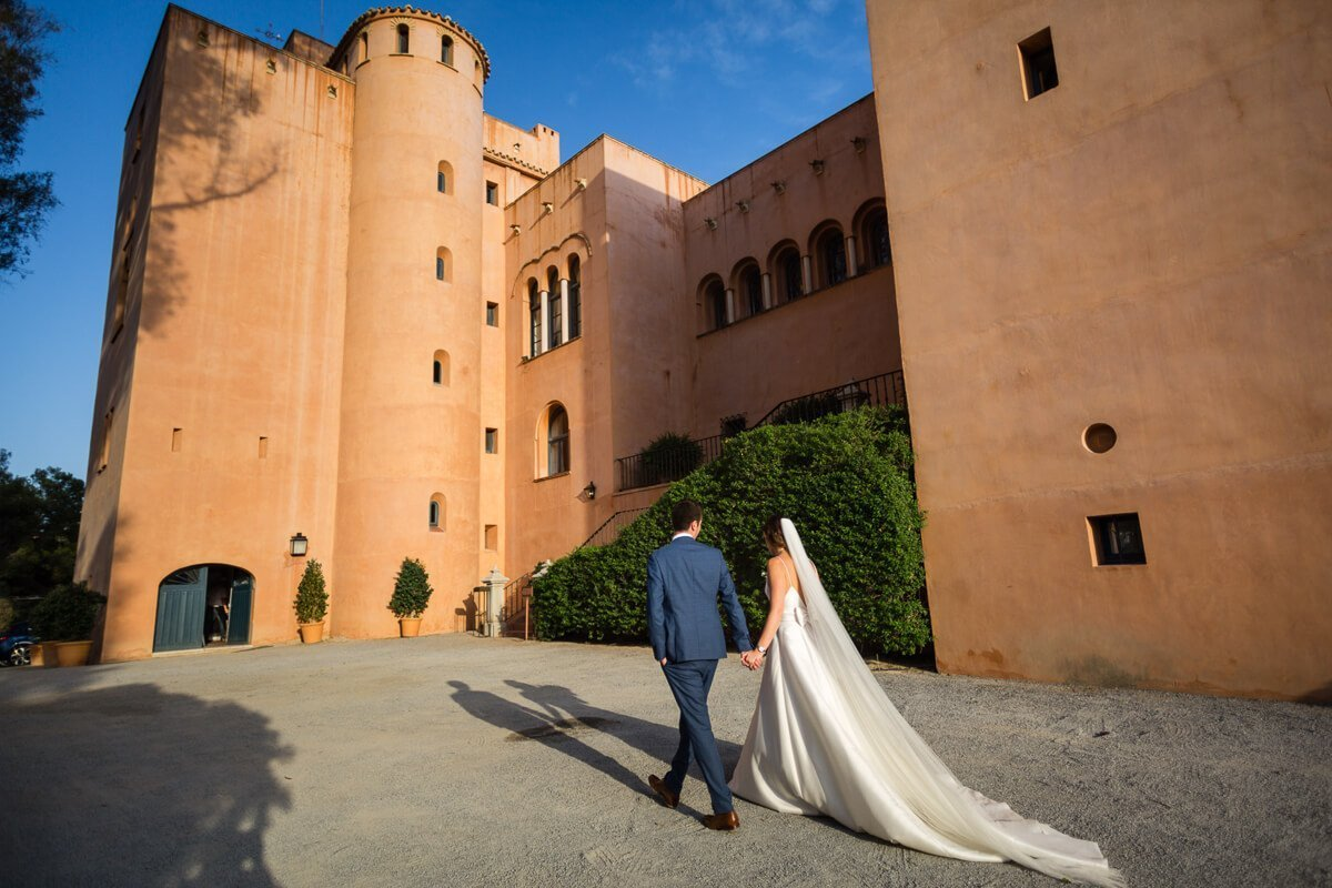 Bride and groom walking outside venue at Wedding in Malaga Spain