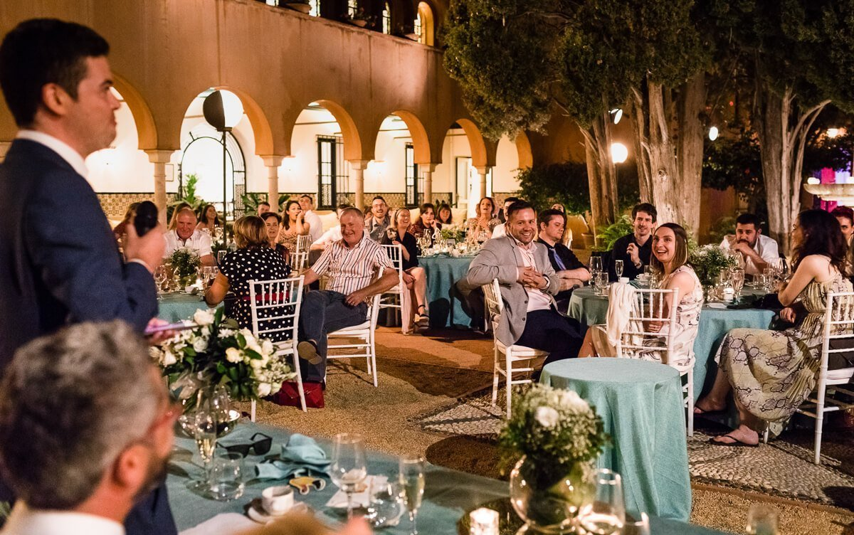 Guests listening to speech at Wedding in the Castillo de Santa Catalina
