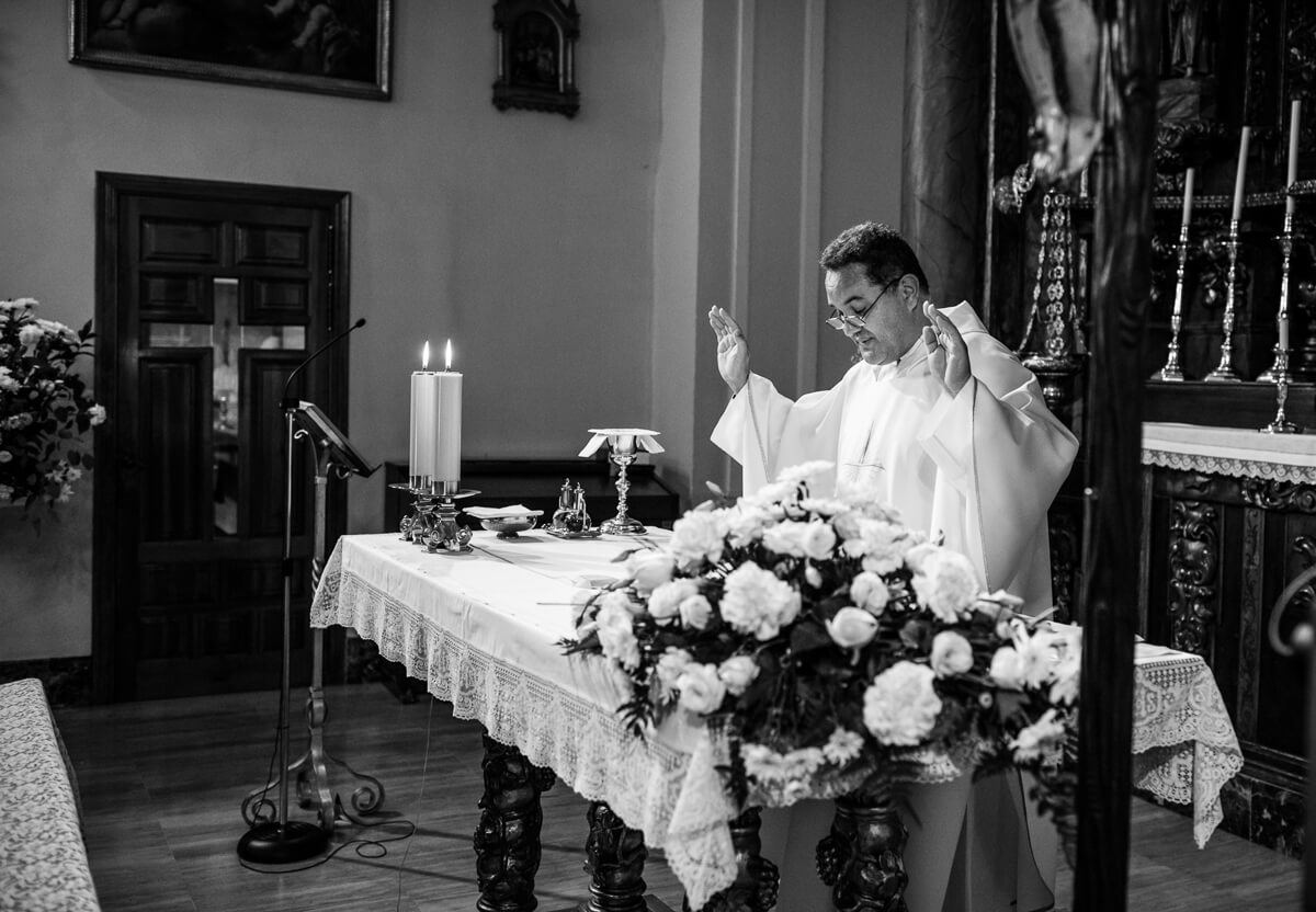 Documentary photo of priest at Spanish wedding