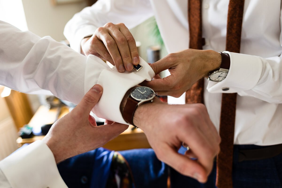 Groomsmen getting ready at documentary wedding