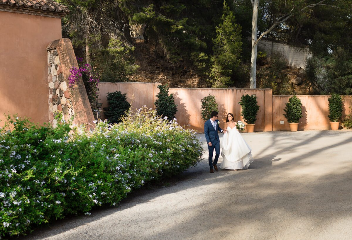 Bride and groom entering Malaga wedding venue